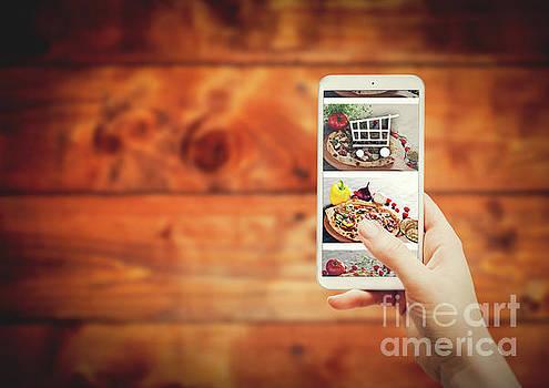 Smartphone with food ordering application by Michal Bednarek
