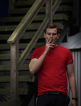 Juan Contreras - Smoker in Red Tshirt