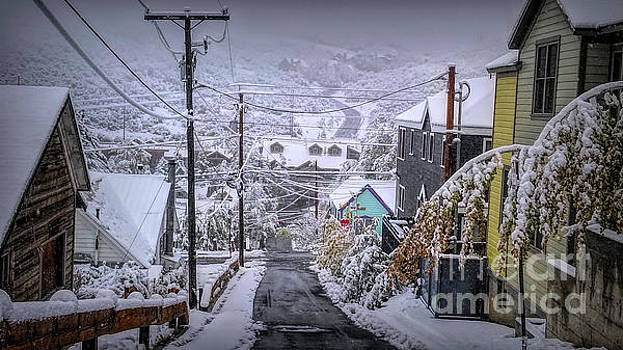 Snow Covered Village by Randy Kostichka