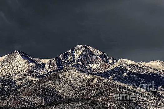 Spring Strom Brewing Over Longs Peak by Jon Burch Photography