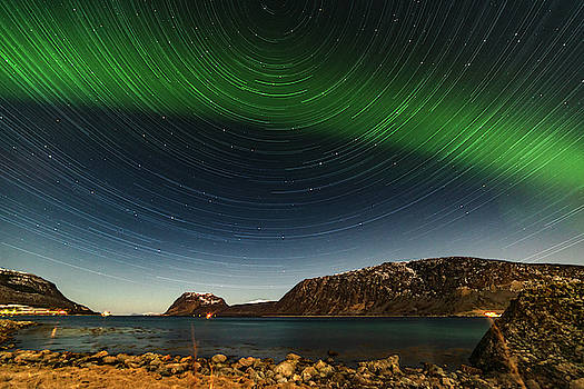 Startrail over Northern Lights by Kai Mueller