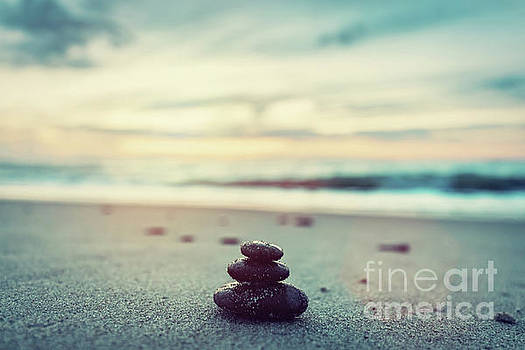 Stones pyramid on the beach at sunset. Zen by Michal Bednarek