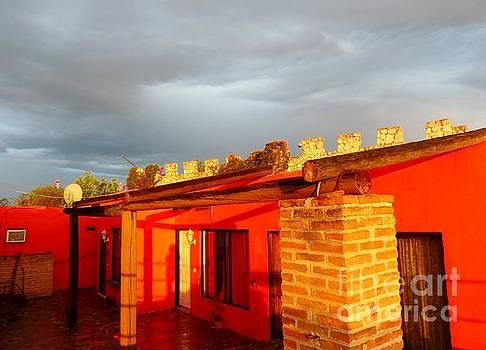 Storm Brewing, Sun Setting by Rosanne Licciardi