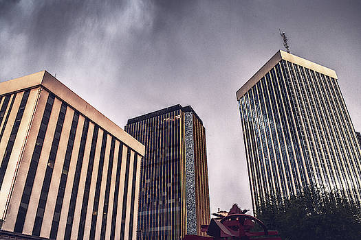 Storm Clouds over downtown Tucson, Arizona buildings by Chance Kafka