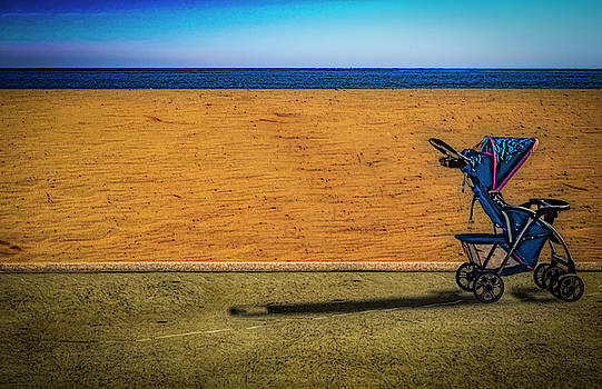 Stroller at The Beach by Paul Wear