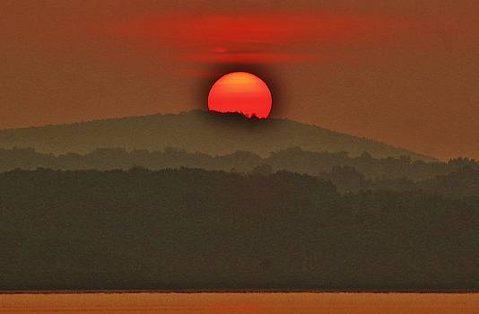 Sun Rises Over The Mountain by Thomas McGuire