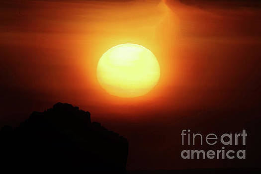 Sunfall behind a rock on the Oregon coast by Jeff Swan