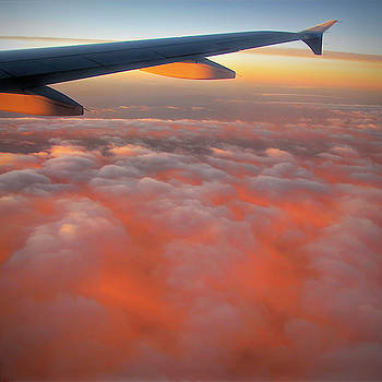 Sunrise Clouds at 32000 Feet by Donna Kennedy
