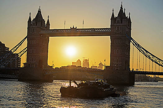 Toby McGuire - Sunrise framed in the Tower Bridge in London UK Thames River