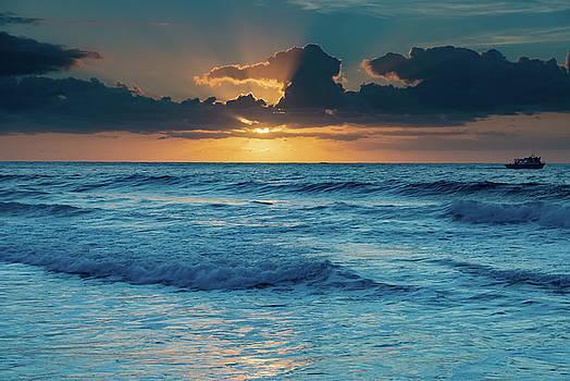 Sunrise Light and a Boat - Seascape by Merrillie Redden