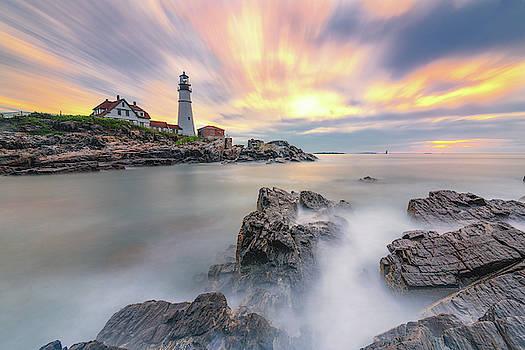Sunrise on the Rocks at Portland Head Light by Jesse MacDonald
