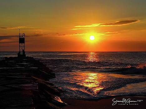 Sunrise over Indian River Inlet by Shawn M Greener