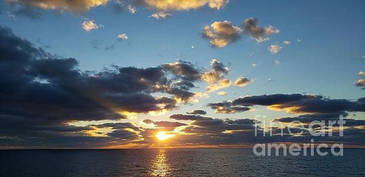 Sunrise over the ocean by Olga Malamud-Pavlovich