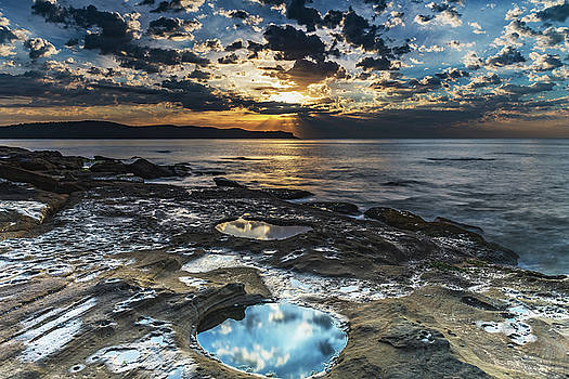 Sunrise Seascape with Clouds and Reflections in the Rock Pool by Merrillie Redden