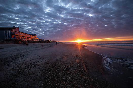 Sunrise walk on the beach by Nick Noble