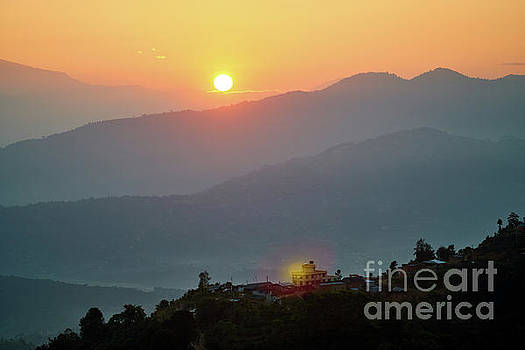 Sunset above mountain in valley Himalayas mountains by Raimond Klavins