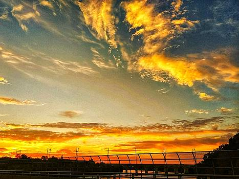 Sunset Crossing Over The Highway by Kathy Gail