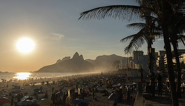 Sunset in Brazil at Ipanema Beach in front of Two Brothers Mountains.  by Ryan Hoel