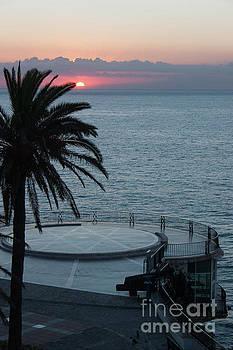 Sunset over a balcony by John Edwards