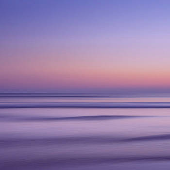 Golden Sunset over a calm ocean in purple and gold by Angie Stimson