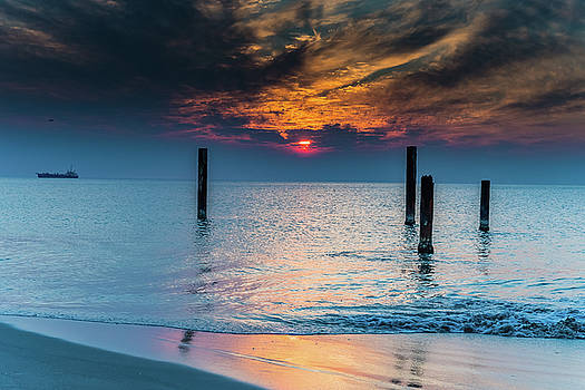 Sunset Seascape with Posts by Merrillie Redden