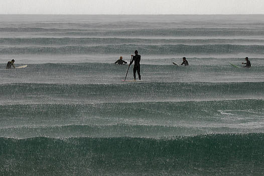Surfers On The Rain by Stelios Kleanthous