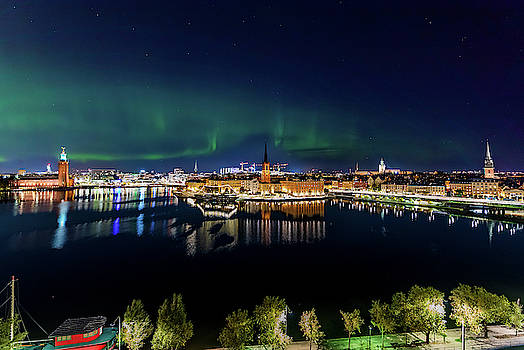 Swirly Aurora Over Stockholm and Gamla Stan by Dejan Kostic