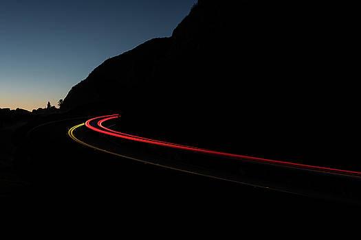 Tail Lights On A Mountain Road by Steve Gadomski