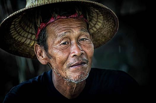 Thai Worker by Lee Craker