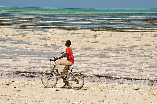 The bike rider on the beach by Yavor Mihaylov