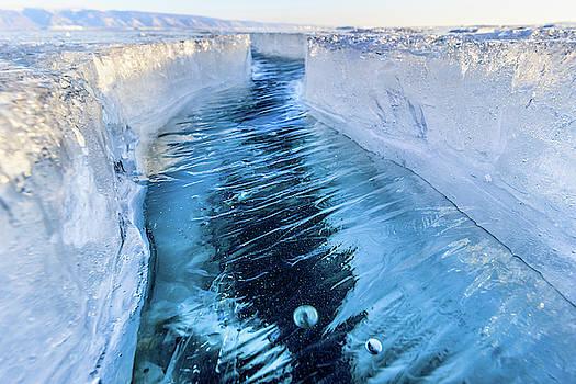 The crack of Baikal ice by Svetlana Korneliuk
