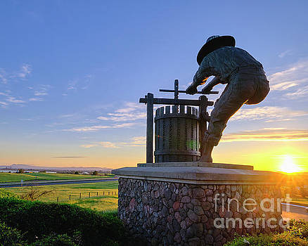 The Grape Crusher at Sunset by George Oze