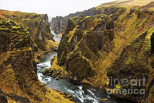 The massive and deep Fjadrargljufur Canyon. by Jamie Pham