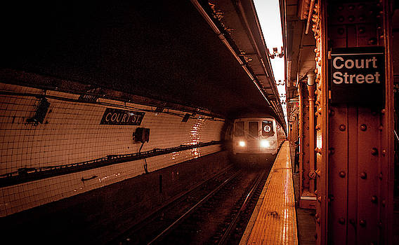 The R train arriving at the Court St Station by Traci Asaurus