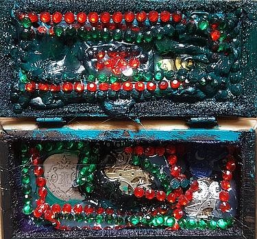 The Sarcophagus  of worldly possessions  by Darrell Black
