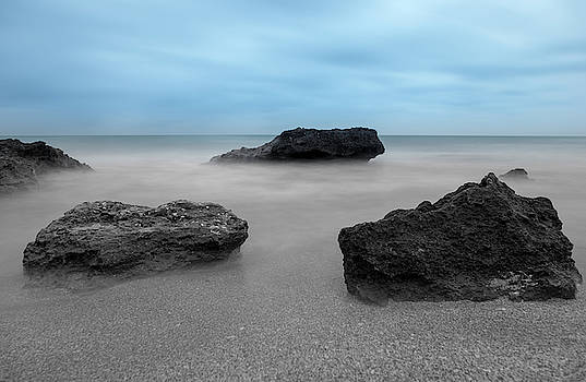 The sea in black and white under blue sky by Vicen Photography