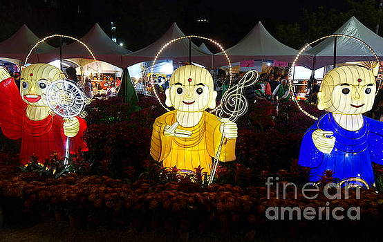 Three Lanterns in the Shape of Buddhist Monks by Yali Shi