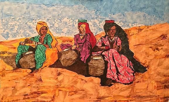 Three women in the desert by Mihira Karra