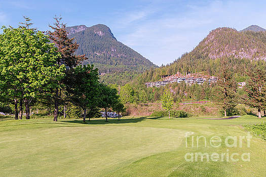 Golf course at the foot of the mountains by Viktor Birkus