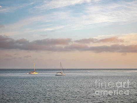 Two Sail Boats in Ocean Sea Facing the Sunset During the Golden  by PorqueNo Studios