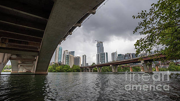Urban Skyline of Austin Buildings from Under Bridge with Stormy  by PorqueNo Studios