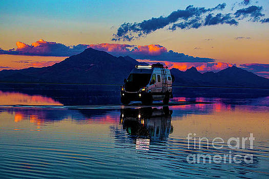 Van parked on the Salt Flats by Randy Kostichka