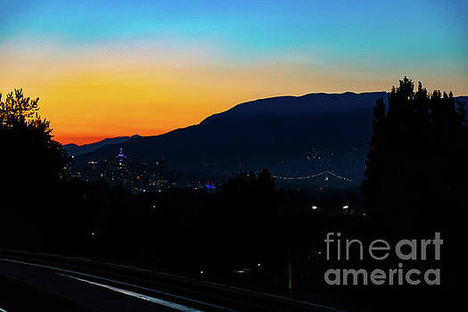 Vancouver in Sunset from Nanaimo Station by Joe Kunzler