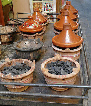 Vegetables steaming in tagine cooking pots by Steve Estvanik