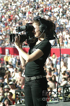 Videographer Taping in a Stadium by Concert Photos