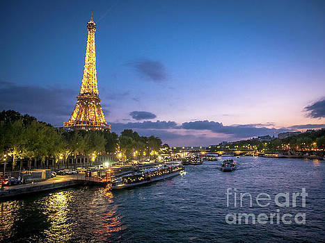 View of the Eiffel Tower During Sunset From the Scene River by PorqueNo Studios