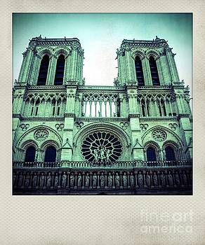 Vintage polaroid photo of facade of Notre Dame Cathedral, Paris, France by Bernard Jaubert