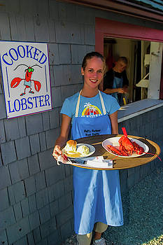 Waitress serving lobster  by David Smith