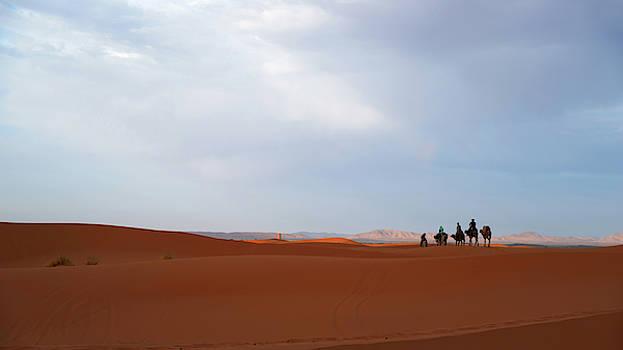Walking the dunes by Yuri San