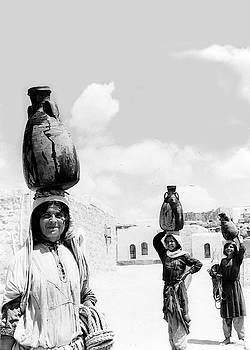 Water Carriers in 1951 by Munir Alawi